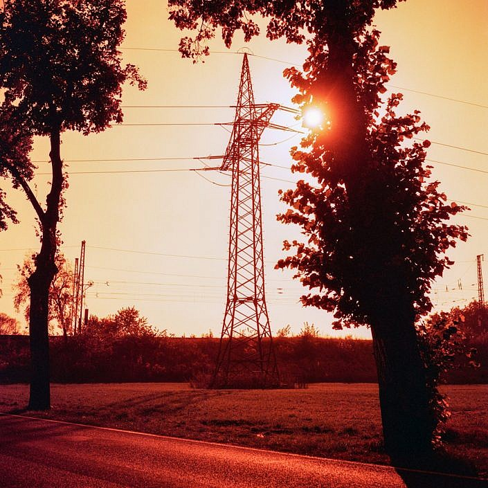 Power pole towards the sun